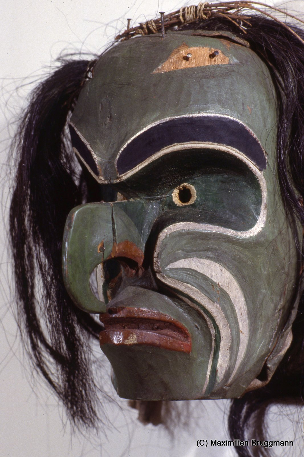 p135. The Lekwiltok Kwakiutl mask represents Bookwus, the wild forest monster.The animal-like earsare missing from the forehead. Confiscated 1n 1922, along with other potlatch goods, the mask was returned 1n 1979 to the new Kwakiutl museum in Quathiaski Cove, located on Quadra Island, British Columbia.