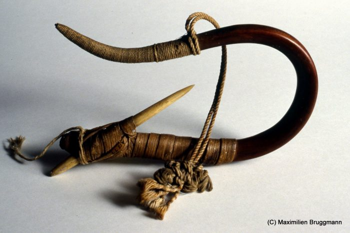 Halibut hook made of yew wood, bent by means of a steaming technique and then hardened, The bone Barb is attached by means of a cedar bark string. Collected from the Haida, but of a type used by the Makash. (16cm, MOA)