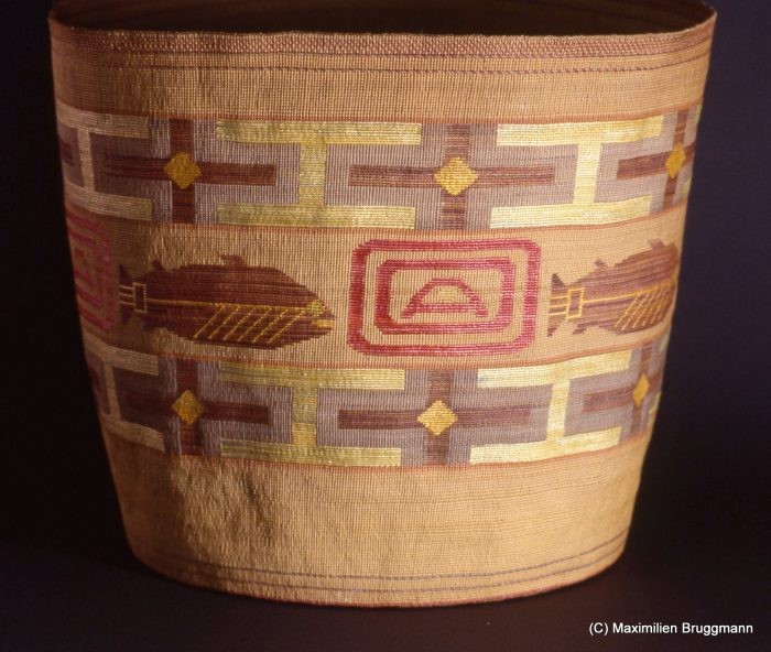 21 This basket, collected around die turn of the century, is a stunning example. It is woven of spruce roots and multicolored grasses. The blue color is created with huckleberries. (38 cm; ASM)