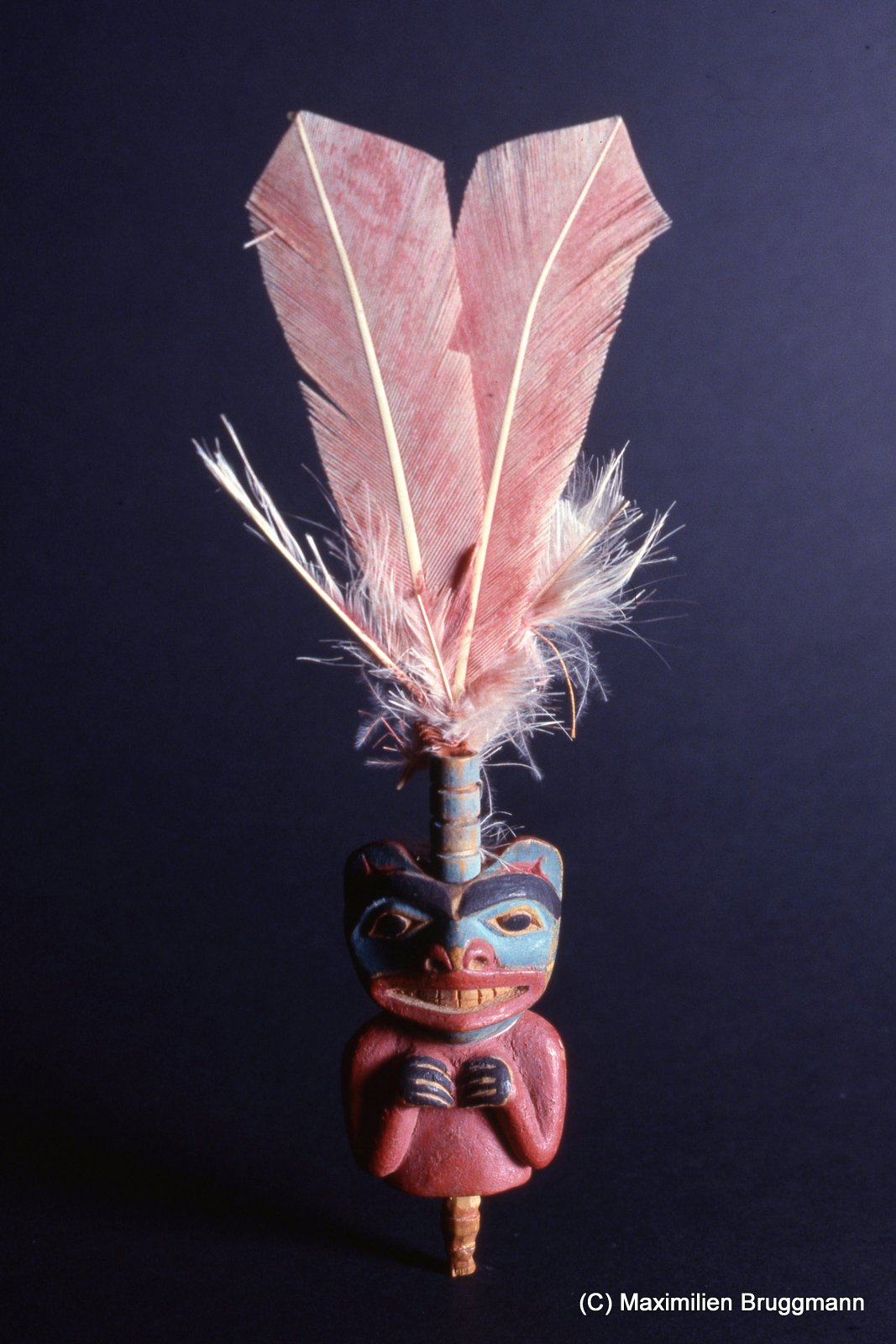 "18 This small bear figurine with its four ""potlatch rings"" was probably part of a larger headdress at one time. (Figure 18 cm; SJM)"